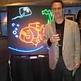 Gregg with neon fish art, for a Georgia Aquarium fundraiser