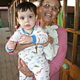Nanny Holds Max; Max Looks Stunned