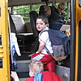 Josh Boarding the Bus to Summer Camp