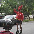 Following Baton Bob, the neighborhood cross-dressing favorite parade leader