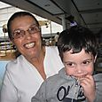Nanny smiles while Max eats his zipper