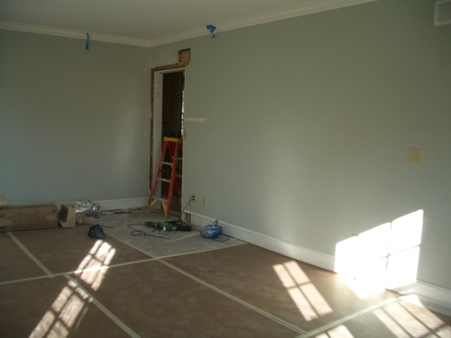 The doorway from dining room to kitchen takes shape