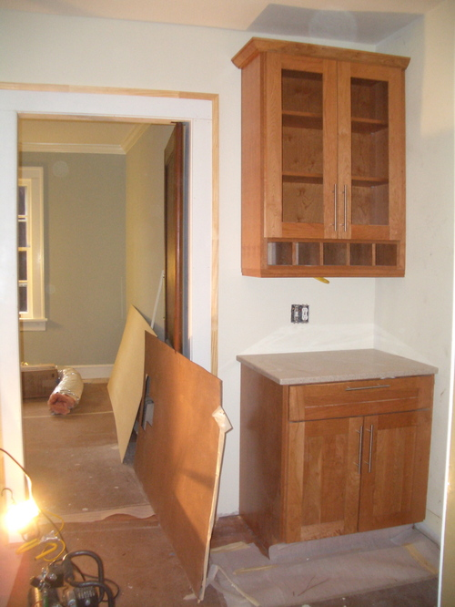 """The """"butler's pantry"""", next to the swing door to the dining room"""